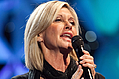 Olivia Newton-John Sings 'Summer Nights' With Rescued Chilean Miner - Olivia Newton-John had a very special guest join her on stage during a concert in Chile's capital …