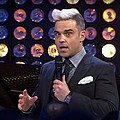 "Robbie Williams announces 'Let Me Entertain You Tour' - In the wake of his recent Twitter birthing videos Robbie Williams will embark on his brand new ""Let …"