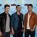 "Jonas Brothers fans devastated - Jonas Brothers fans are ""heartbroken"" about the band's tour cancellation.The trio were supposed to …"