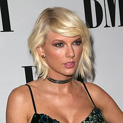 Taylor Swift performs at fan's wedding