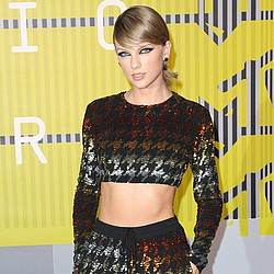 Taylor Swift jams with Nelly at birthday bash