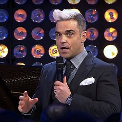 Robbie Williams pays tribute to mentor David Enthoven