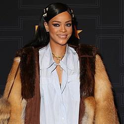 Rihanna bares all for hard-hitting, gun-toting new video