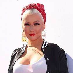 Ariana Grande to replace Whitney Houston as Christina Aguilera's duet partner
